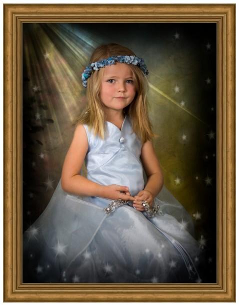little girl in blue dress in ornate gold frame